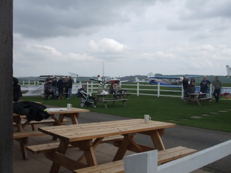 Old Sarum Airfield Cafe View of the Grass Runway and Parking Area